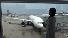 4k beautiful asian woman looking the plane in the Hongkong airport-Dan - stock footage