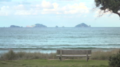 Lonely park bench with ocean backdrop HD Stock Footage