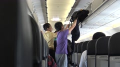 4k Interior airplane travelers boarding a plane and save luggages-Dan Stock Footage