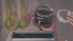 Pouring Coffee Beans into Coffee Machine Stock Footage