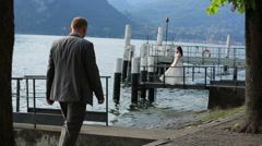 Happy wedding couple walking on the berth in Como, Italy Stock Footage