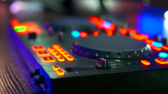 Musical equipment, DJ mixer on table at night club Stock Footage