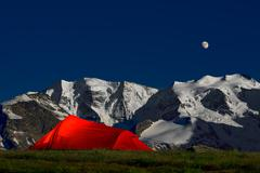 Tent in the solitude beneath the glaciers of the Alps Stock Photos