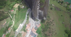 Aerial looking down over the Piedra del Penol of Guatape Stock Footage