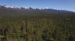 Aerial Zoom of Montana Snow Capped Mountain Forest Stock Footage