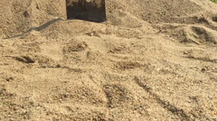 Slow motion shovel falling down on the sand Stock Footage