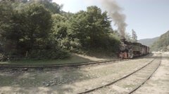 Old steam train starts moving, Romania, Valea Vaserului Stock Footage