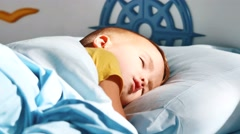five years old sleeping little boy in bed - stock footage