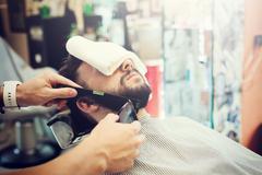Traditional ritual of shaving the beard Stock Photos