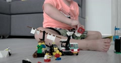 The Boy Playing With Lego Pieces at Home Stock Footage