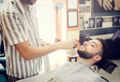 Traditional ritual of shaving the beard Stock Photos