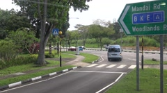 4k, View of traffic on road in Singapore, crosswalk with cars and trees-Dan Stock Footage