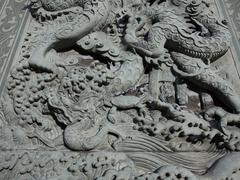 Dragon carved wall in Chinese temple - stock photo