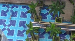 4k Aerial view of woman swimming across the luxury pool at the resort hotel-Dan - stock footage