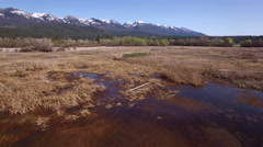 Snow Capped Mountains Over Montana Marsh Stock Footage