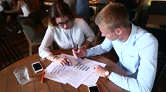 Young business team agree, look at documents graphicks, resolve Stock Footage