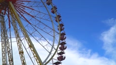 Bottom view onto a rotating Ferris wheel Stock Footage