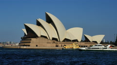 Australia Sydney Opera House traditional and modern ferries pass by Stock Footage