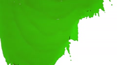 Green paint flowing down slowly. clear liquid Stock Footage