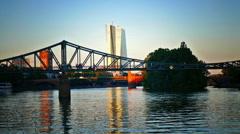 Skyline of ECB EZB Frankfurt am Main Eisener Steg bridge at dusk Germany Europe Stock Footage