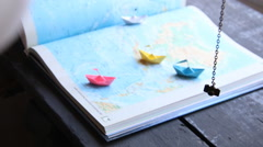 Travel the world idea, summer holiday - paper boats on the map Stock Footage