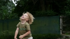 Boy blows bubbles in the garden on a summer day. Stock Footage