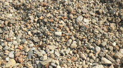 Slow motion pebbles falling onto more pebbles Stock Footage