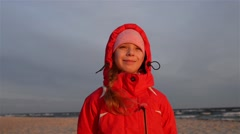 Beautiful smiling girl on Baltic coast Stock Footage