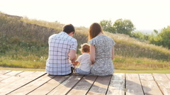 happy young family spending time outdoor on a autumn day - stock footage
