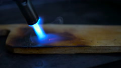 Burning out of a wooden board Stock Footage
