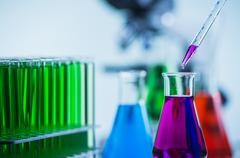 Pipetting coloured liquid into Beaker, Chemical, Science, Labora Stock Photos