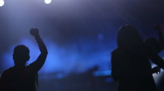Young people dancing on the stage, crowd partying at a rock concert - stock footage