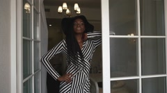 Seductive african american black lady in elegant black hat and summer outfit Stock Footage
