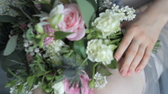A Bouquet of Flowers and a Female Hand Stock Footage