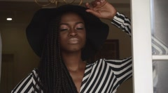 Close-up of elegant sexy african american female model in black hat and striped - stock footage