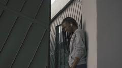 Thoughtful young african american woman enjoying music on earphones - stock footage