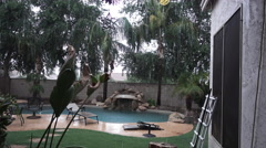 Establishing Shot of Residential Arizona Backyard Pool in a Monsoon Stock Footage