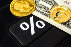 How many percent is gold and american dollar going up or down.. Stock Photos