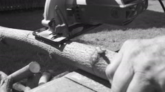 The old man sawing wood Stock Footage