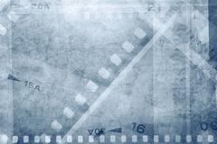 Film negative frames on blue background Kuvituskuvat