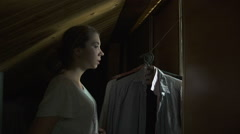 Frightened girl comes out of the closet Stock Footage