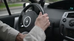 A man drives Renault, turn the steering wheel of a vehicle Stock Footage