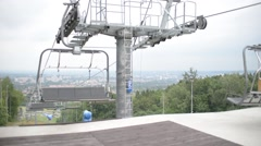 Cable car, chair lift, cable pulls tourists up the green mountain Stock Footage