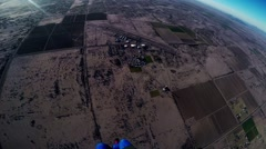 Professional skydiver parachuting in blue sky over Arizona. Sunny. Sandy country Stock Footage