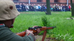 German soldier of first world war shoots from mashine-gun on the historical show Stock Footage