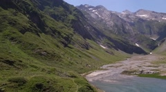 Aerial view of lake and Cirque de Gavarnie, France Stock Footage