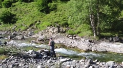 Fisherman trout fishing with bait in mountain river - stock footage