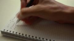 Handwriting math formulas in exercise book closeup time lapse 4k UHD (3840x2160) - stock footage
