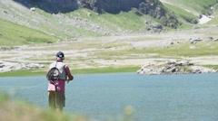 Flyfisherman fishing in mountain lake Stock Footage