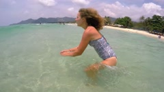 Young Woman Diving in Tropical Sea on Vacation. Slow Motion. Stock Footage